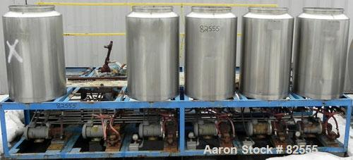 """Used- Multi Tank Feed System Consisting Of: (5) 75 Gallon 304 stainless steel tanks, 24"""" diameter x 36"""" straight side. Open ..."""