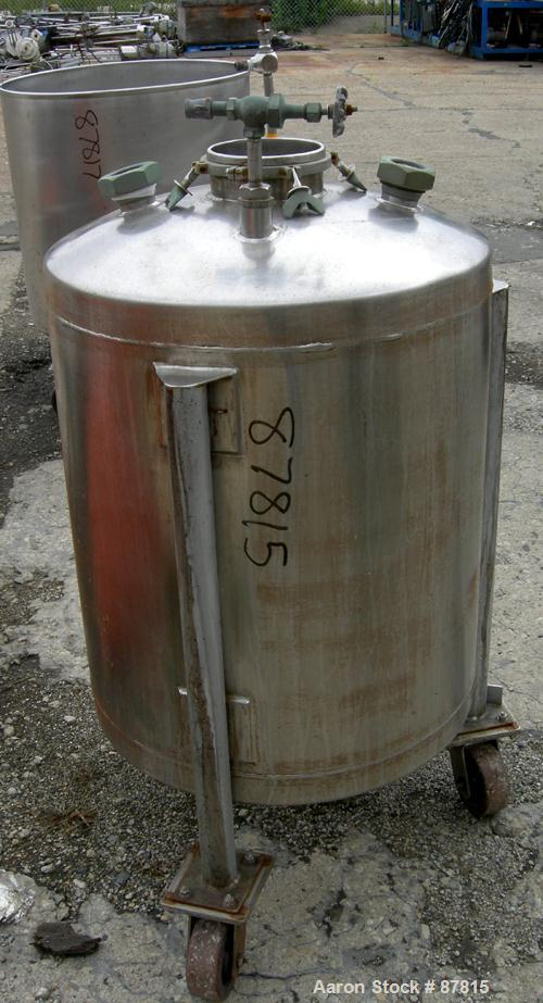 "Used- Tank, 55 Gallon, 321 Stainless Steel, Vertical. 24"" Diameter X 28"" straight side, dish top and bottom. Openings:  top ..."