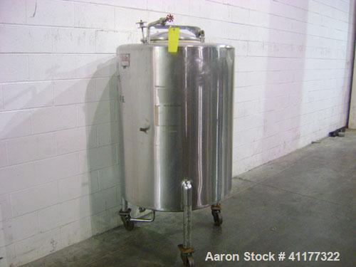 Used- Perma-San Tank, 150 gallon, stainless steel, vertical. Closed top with manway, sloped bottom. Mounted on 3 legs with c...