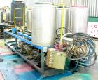USED: Multi tank feed system consisting of (7) 75 gallon 304 stainless steel tanks, 24