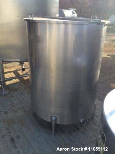 "Used- 450 Gallon Sanitary Stainless Steel Tank. 4' diameter x 4'10"" T/T. Mfg. by Harry Holland and Son. Hinged lid, slope bo..."