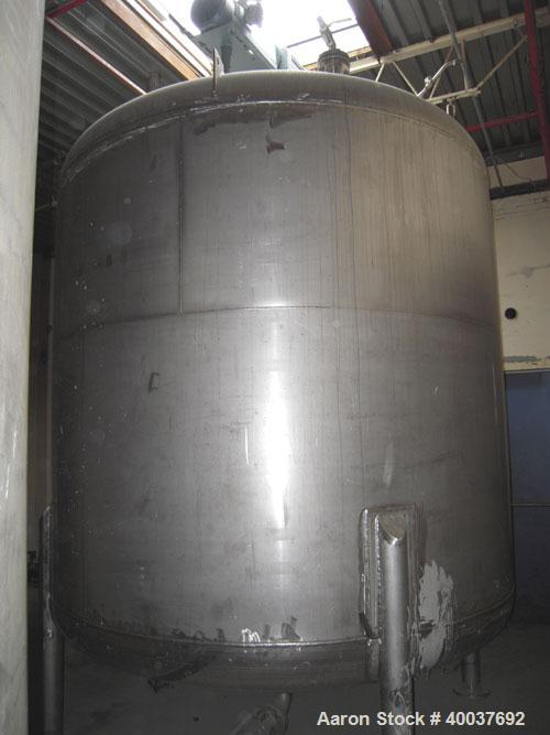 "Used- Douglas Brothers Pressure Tank, 3000 gallon, Stainless steel, Vertical. Approximately 96"" diameter x 84"" straight side..."