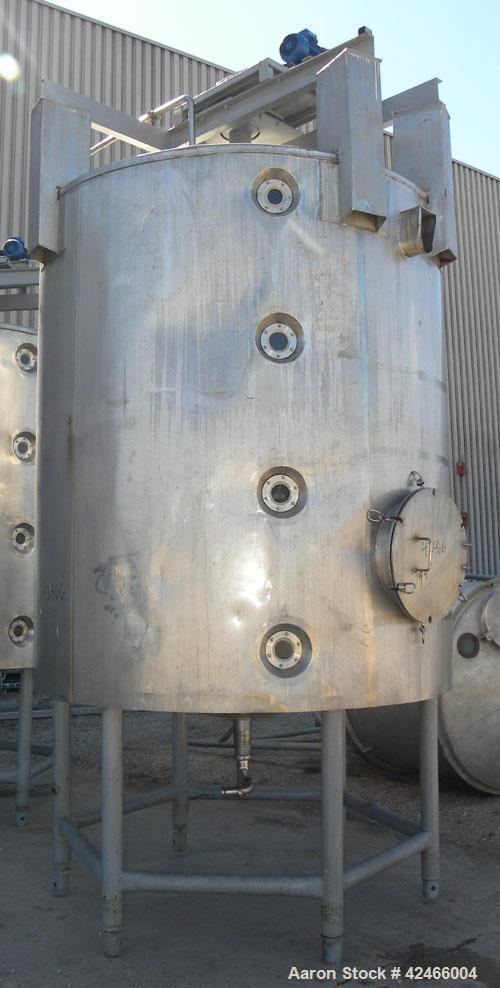 "Used-Tank, 2500 Gallon, 304 Stainless Steel, Vertical. 87"" diameter x 98"" straight side, cone top and bottom. (2) internal s..."