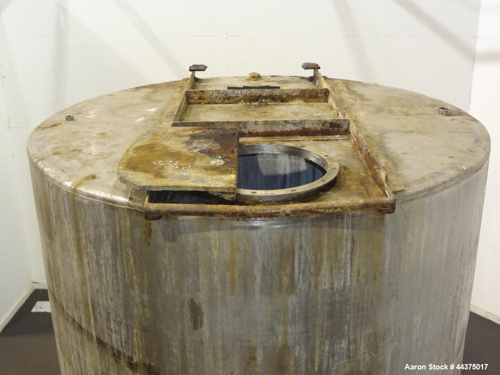 "Used- Tank, 3000 Gallon, 304 Stainless Steel, Vertical. Approximate 84"" diameter x 118"" straight side, flat welded top, cone..."