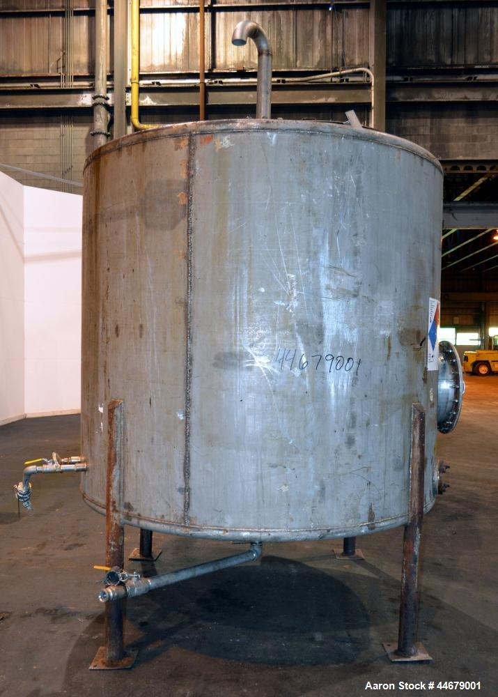 """Used- Tank, 1800 Gallon, 304 Stainless Steel, Vertical. Approximate 84"""" diameter x 72"""" straight side, coned top and bottom. ..."""