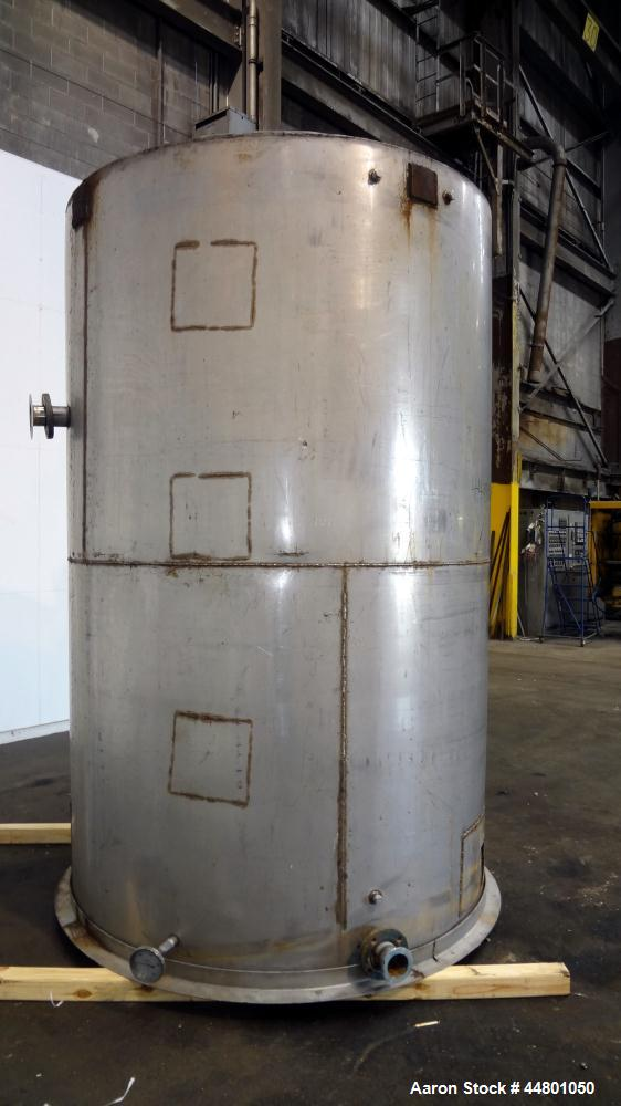 """Used- Tank, 2300 Gallons, 304 Stainless Steel, Vertical. Approximately 76"""" diameter x 120"""" straight side, coned top, flat bo..."""