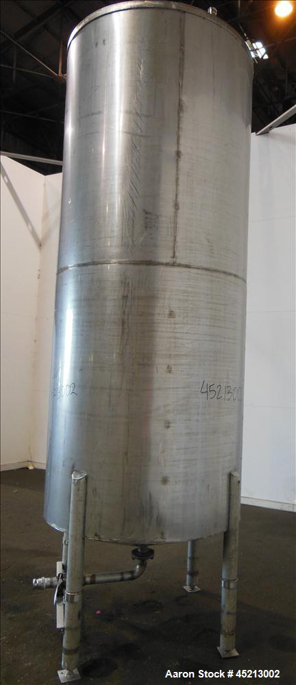 """Used- Tank, 1100 Gallon, 304 Stainless Steel, Verical. 52"""" Diameter X 120"""" straight side. Coned top and bottom. Openings top..."""