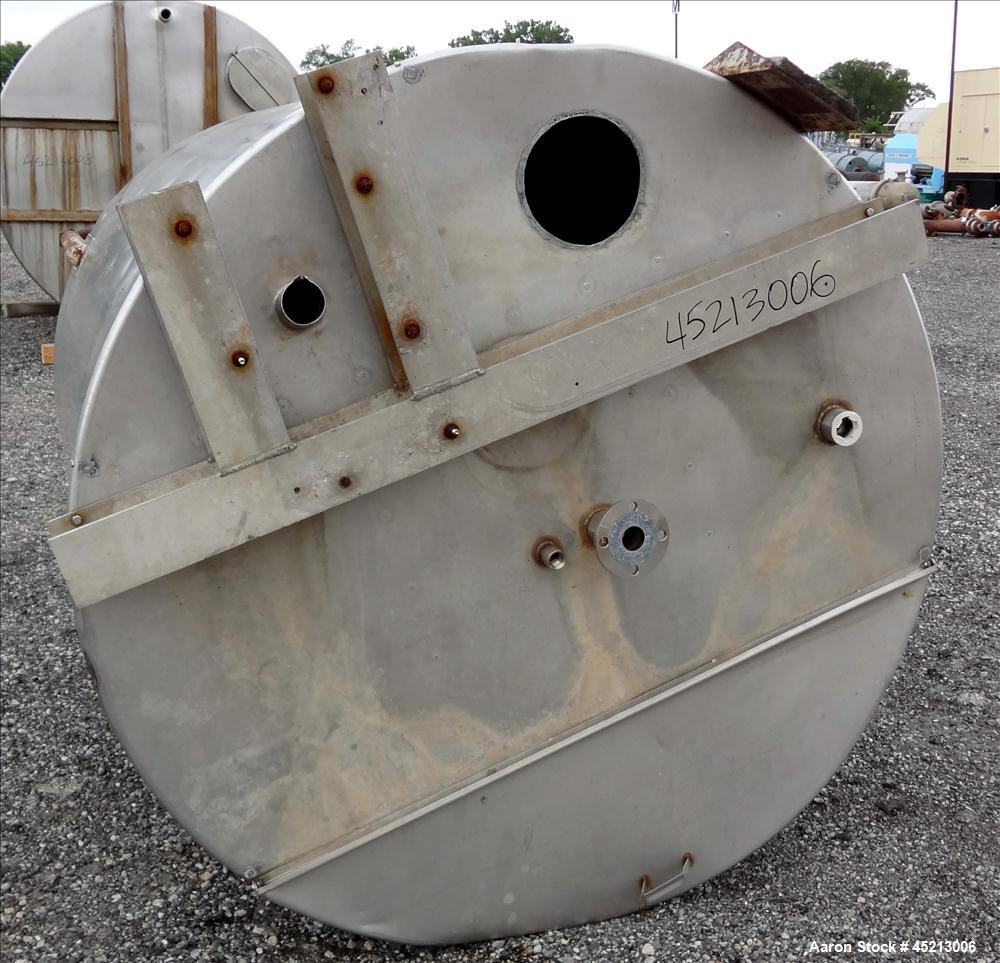 "Used- Tank, 1300 Gallon, 304 Stainless Steel, Vertical. Approximately 68"" diameter x 83"" straight side, flat top with a 1/3 ..."
