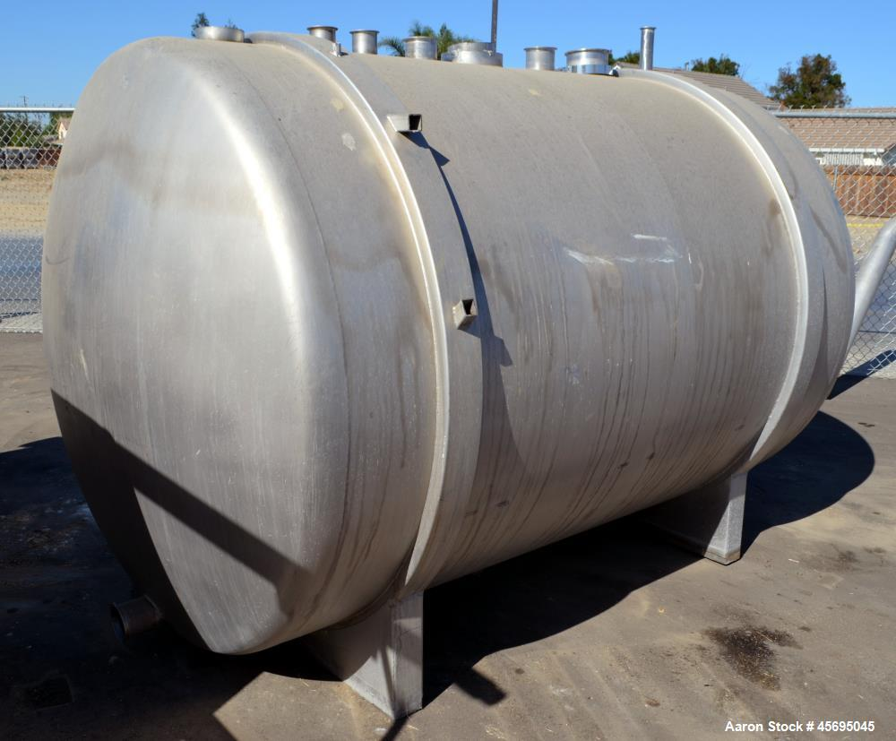 "Used- Tank, 1400 Gallon, Stainless Steel, Horizontal. 66"" Diameter x 82"" straight side, dished heads. Openings top (3) 1-1/2..."