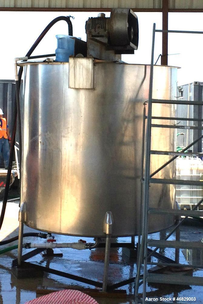 Used- 1000 Gallon Stainless Steel Mixing Tank. Cone bottom, split covers with 10HSP GE motor.