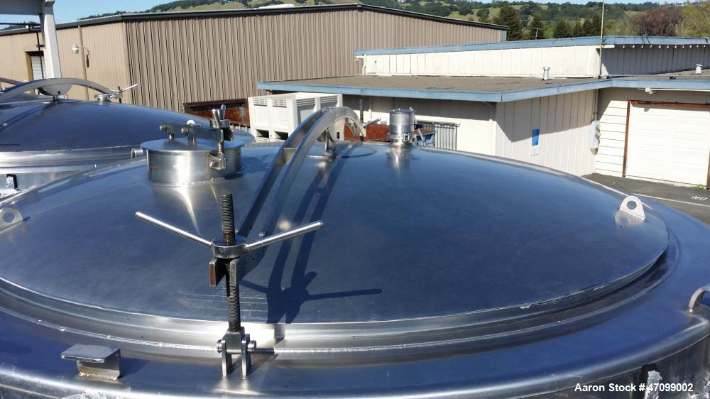 "Used- Approx. 3000 Gallon Stainless Steel Jacketed Wine Tank. Approx. 96"" diameter x 96"" straight side. Open top with a stai..."