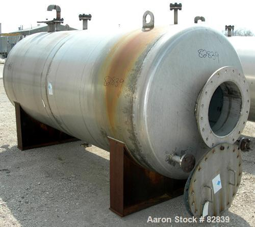 """USED: Tank, 1,250 gallon, 304 stainless steel, horizontal. 54"""" diameter x 120"""" straight side, dished ends. Openings: top (2)..."""