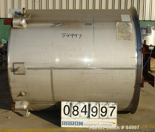 "USED: 1000 gallon 304 stainless steel vertical mixing tank. 66"" diameter x 72-1/2"" straight side. Bridge mounted gearmotor, ..."
