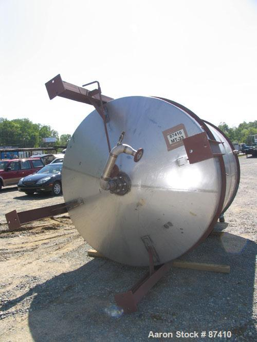"USED: Tank, 2650 gallon, 316 stainless steel. 7'4"" diameter x 8'2"" straight side, flat top with manway, cone bottom, interna..."