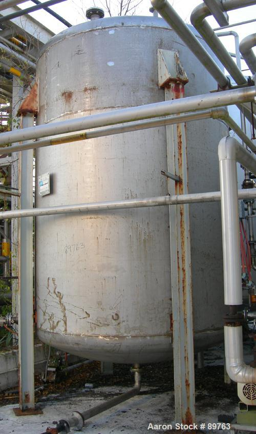 """USED: Approximate 5000 gallon stainless steel storage tank. Approximate 8'-6"""" diameter x 11' straight side. Dished heads. Mi..."""