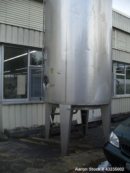 Used-Azzini Stainless Steel Tank, 2246 gallons (8,500 liters).  Mounted on four legs with bottom discharge.  Height 14.8' (4...