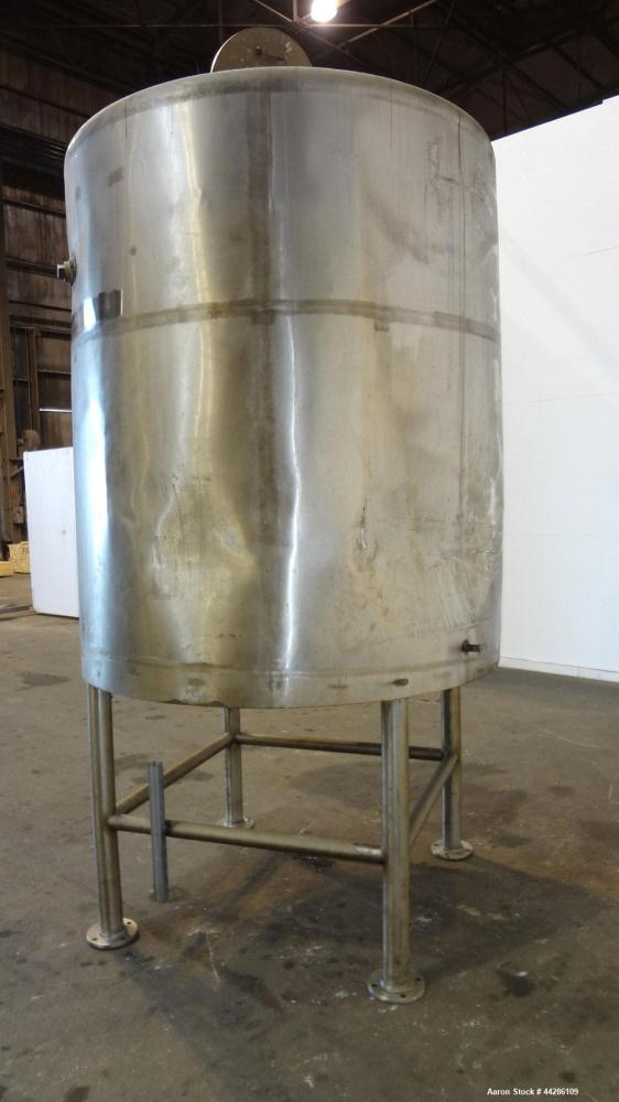 """Used- C.E. Howard Tank, 1000 Gallon, 304 Stainless Steel, Vertical. 66"""" Diameter x 73"""" straight side. Flat top, sloped botto..."""