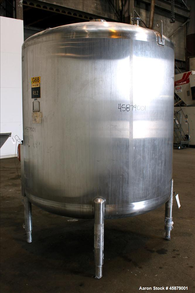 "Used- Cherry Burrell Type C Tank, Model CVS, 1,000 Gallon, 304 Stainless Steel, Vertical. Approximately 64"" diameter x 60"" s..."
