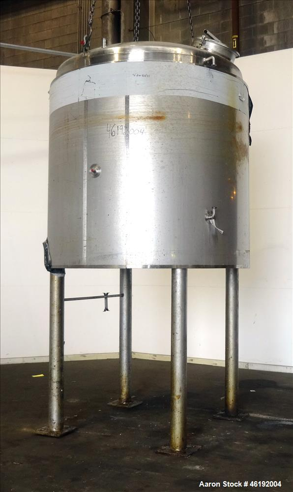 "Used- Custom Metalcraft Tank, Model 1188300, 1,321 Gallon, 304 Stainless Steel, Vertical. Approximately 76"" diameter x 60"" s..."