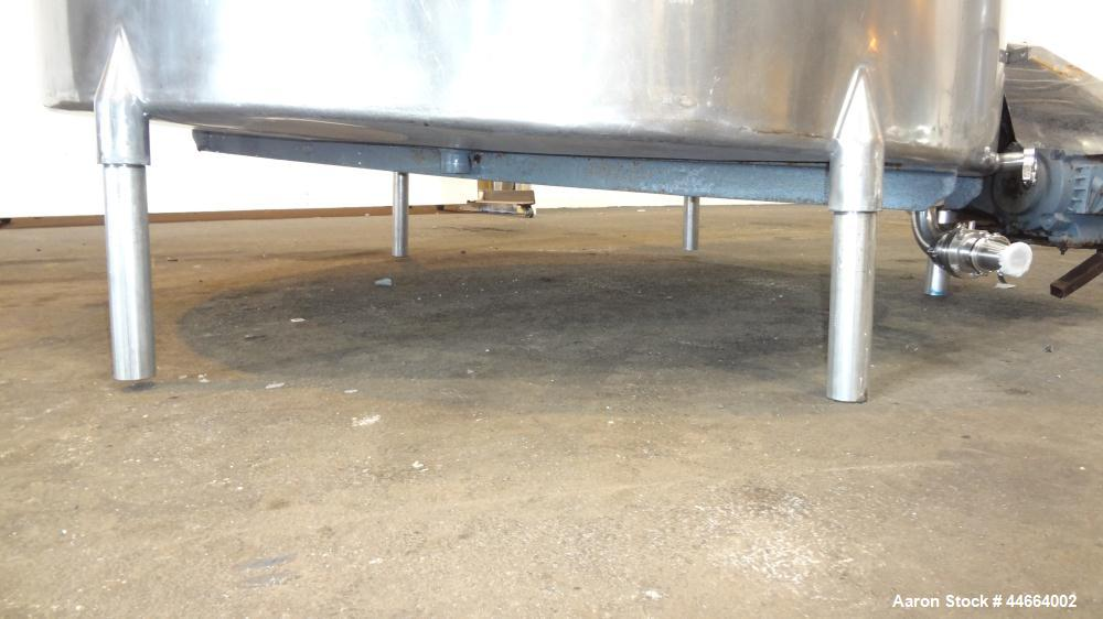 "Used- Filpaco Tank, 2000 Gallons, 304 Stainless Steel, Vertical. Approximate 86"" Diameter X 81"" straight side, open top with..."