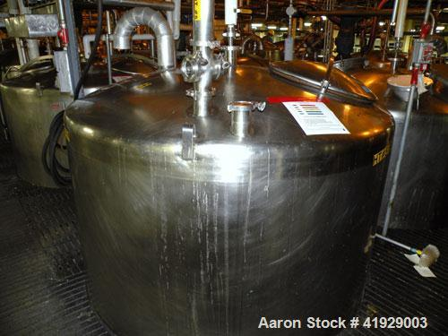 """Used- Mueller Tank, 2000 Gallon, Model F, Stainless Steel, Vertical. 76"""" diameter x 106"""" straight side, dished top and botto..."""