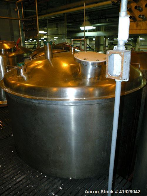 """Used- Mueller Tank, 2000 Gallon, Stainless Steel, Vertical. 76"""" diameter x 106"""" straight side, dished top and bottom. Openin..."""