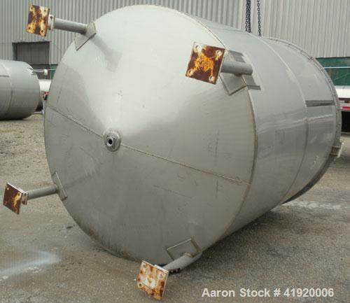 """Used- Tank, 4200 Gallon, 304 Stainless Steel, Vertical. 100"""" diameter x 120"""" straight side, flat open top with a bolt on cov..."""