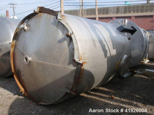 """Used- Tank, 2800 Gallon, 316 Stainless Steel, Vertical. 84"""" diameter x 116"""" straight side, coned top and bottom. Openings: t..."""