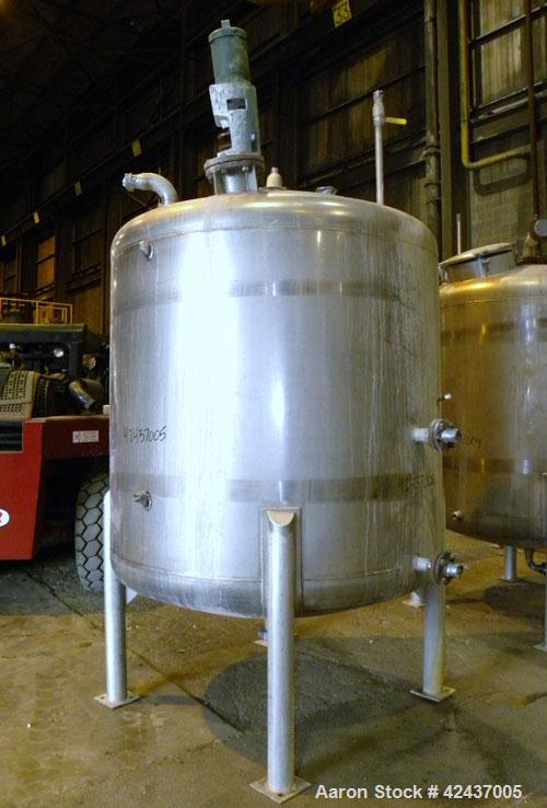 """Used- Tank, 1075 Gallon, 304 Stainless Steel, Vertical. 72"""" Diameter x 60"""" straight side, dished top and bottom. Off center ..."""