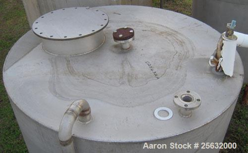 "Used- Tank, 1400 Gallon, Stainless Steel, Vertical. 66"" diameter x 90"" straight side.  Slight dish top, slope bottom. Top Op..."