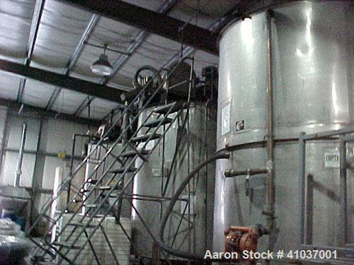 "Used- Tank, 3200 Gallon, 93"" diameter x 11'2"" height. 316 Stainless Steel, Vertical. Open top, Mixer System: Single S.S. sha..."