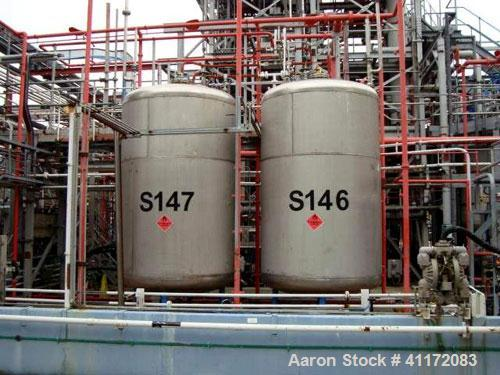 Used- Tank, Approximately 2457 Gallon (9,300 liter), Stainless Steel, Vertical.
