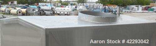 """Used- Rectangular Tank, 1500 Gallon, 316 Stainless Steel, Vertical. Approximately 76"""" long x 48"""" wide x 94"""" tall. Gabled top..."""