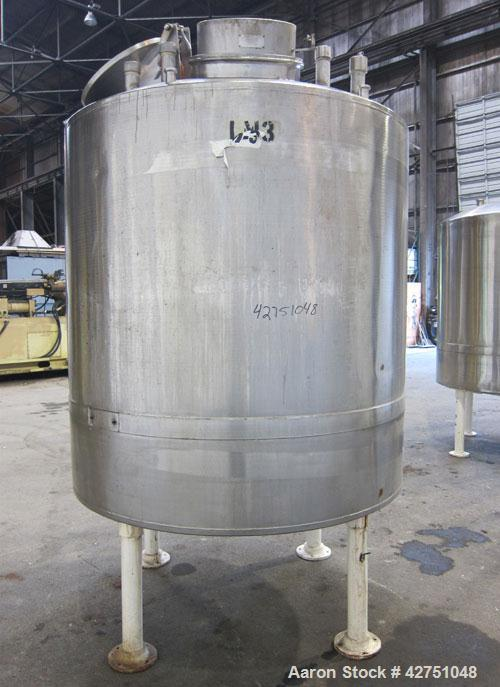 "Used- Tank, 1000 Gallon, 304 Stainless Steel, Vertical. 66"" Diameter x 64"" straight side, dished top, coned bottom. Off cent..."