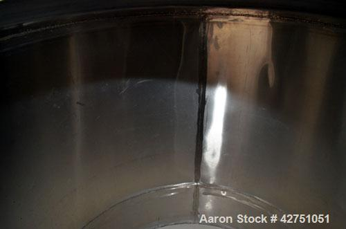 """Used- Tank, 1000 Gallon, Stainless Steel, Vertical. 66"""" Diameter x 66"""" straight side, dished top, coned bottom. Openings top..."""