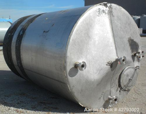 """Used- Tank, 2000 Gallon, 304 Stainless Steel, Vertical. 72"""" Diameter x 116"""" straight side. Cone top, sloped bottom. Openings..."""