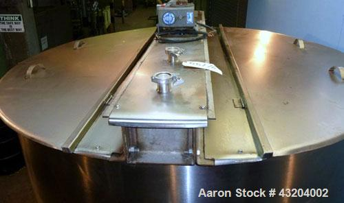 Used- Tank, 1,200 Gallon, Stainless Steel, Vertical. Open top with lids, dished bottom. Side mounted level gauge and bridge ...