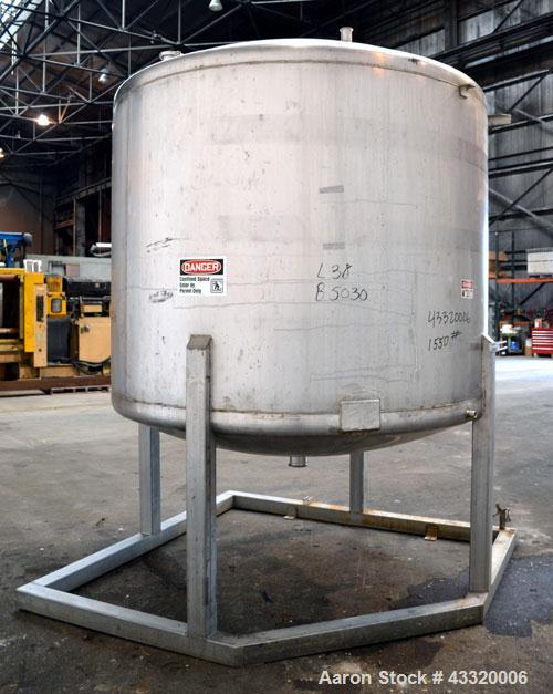 "Used- Tank, 1650 Gallon, 316 Stainless Steel, Vertical. Approximate 84"" diameter x 60"" straight side, dished top and bottom...."