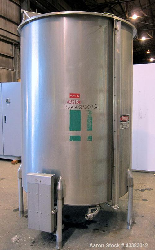 """Used- Tank, 1000 Gallon, 304 Stainless Steel, Vertical. Approximate 61"""" diameter x 81"""" straight side, flat top with a bolt o..."""