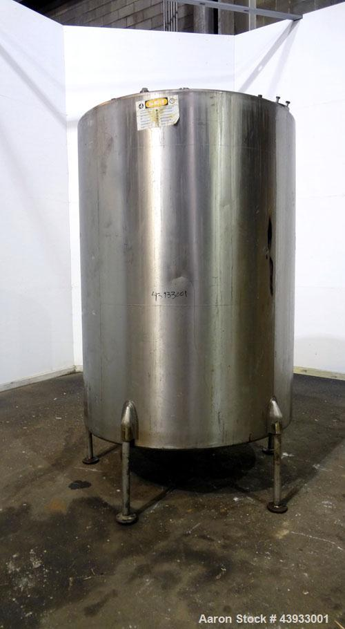 "Used- Tank, 1050 Gallons, 304 Stainless Steel, Vertical.  Approximately 62"" diameter x 82"" straight side.  Flat top, sloped ..."