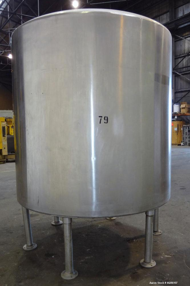 "Used- Tank, 2000 Gallon, 304 Stainless Steel, Vertical. 84"" Diameter x 80"" straight side. Dished top, coned bottom. Openings..."
