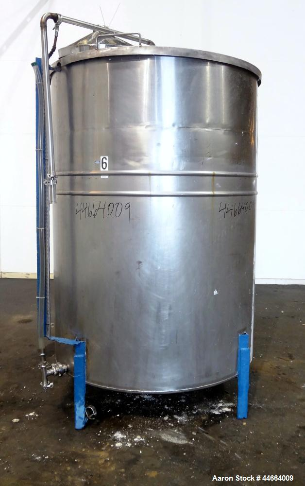"Used- Tank, 1000 Gallons, 304 Stainless Steel, Vertical. 61"" Diameter X 82"" straight side, flat top, coned bottom. Side bott..."