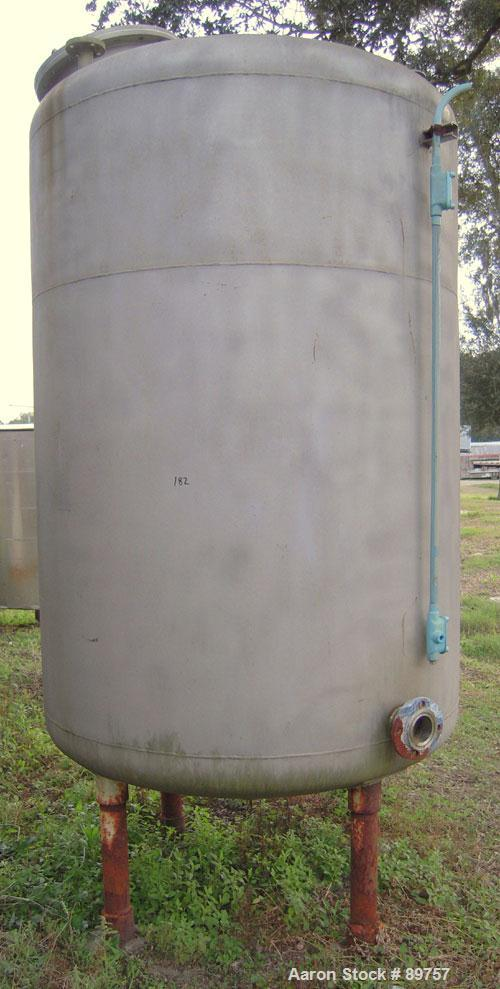 "Used- Tank, 1000 Gallon, stainless steel, vertical. Approximately 54"" diameter x 76"" straight side. Dish top and bottom. Ope..."