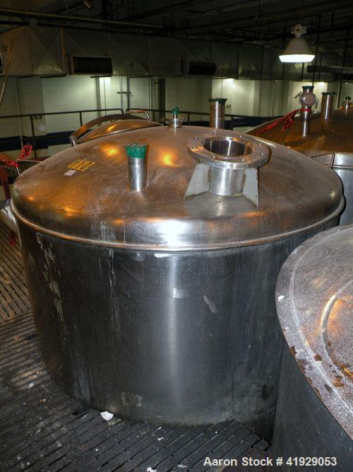 """Used- Norwalk Tank, 2000 Gallon, stainless steel, vertical. 76"""" diameter x 106"""" straight side, dished top and bottom. Openin..."""