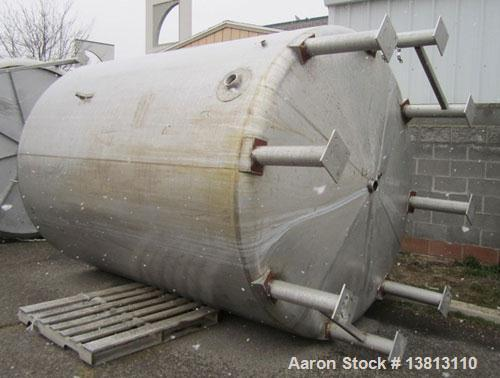 "Used-Sani Tank Stainless Steel Storage Tank, 3,000 Gallons.  3"" Bottom discharge, top manway, 6 inlets:  (2) 2.5"", (3) 3.5"" ..."