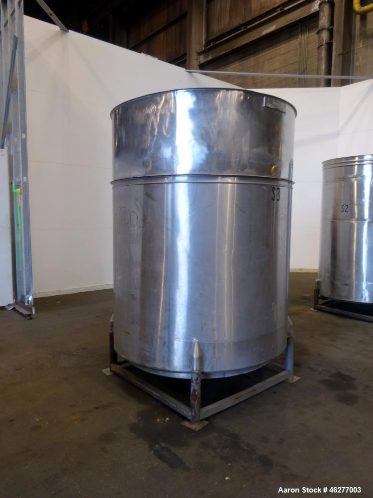 """Used- Tank, Approximately 1,000 Gallons, 304 Stainless Steel, Vertical. Approximately 62"""" diameter x 79"""" straight side. Flat..."""
