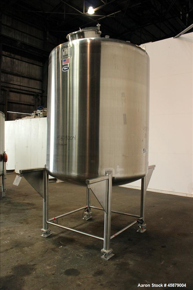 """Used- T&C Stainless Tank, 1,000 Gallon, 316L Stainless Steel, Vertical. Approximately 65"""" diameter x 70"""" straight side. Dish..."""