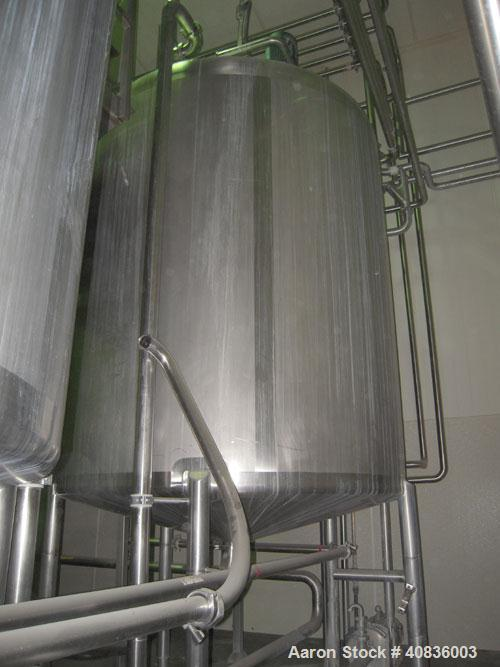 """Used- Walker Stainless Tank, 1000 gallon, 316 stainless steel, vertical. 66"""" diameter x 72"""" straight side, dished top, coned..."""