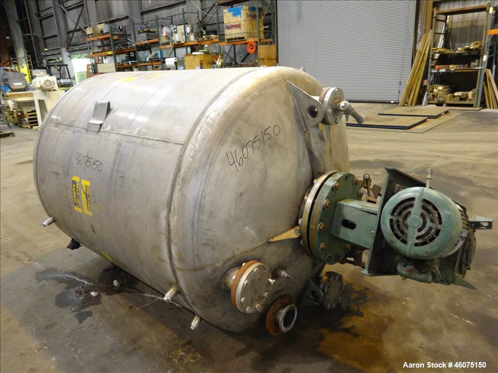 "Used- Tank, 800 Gallon, 304 Stainless Steel, Vertical. Approximate 60"" diameter x 60"" straight side, dished top & bottom. To..."