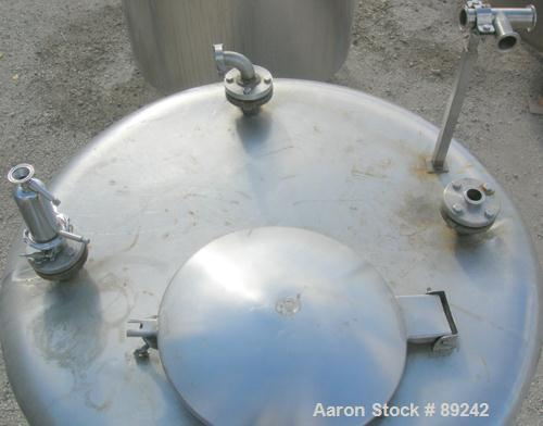 """USED: Tank, 550 gallon, 316 stainless steel, vertical. 50"""" diameter x 64"""" straight side. Flat top, slight coned bottom. Open..."""